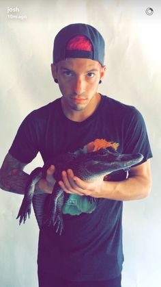 one question. Why is Josh holding a Caiman?