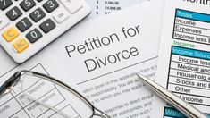 Close up of a petition for divorce with pen and calculator.