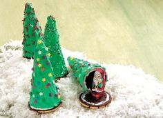 Secret Santa Trees-A creative and edible party favor for each guest, these cookie trees that reveal a hidden Santa chocolate will be the talk of the holidays.