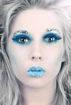 I like the blue against the white. | Want more Halloween makeup ideas? Follow http://www.pinterest.com/thevioletvixen/halloween-makeup-insanity/