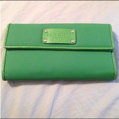 Authentic Kate Spade Wallet Wallet looks great, used one time. Larger size to hold checkbook. Trade value is $75 kate spade Bags Wallets