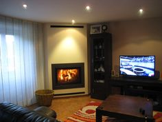Ann quintana on pinterest - Como decorar un salon con chimenea ...