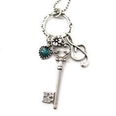 Skeleton Key and Treble Clef Music Themed Necklace in Silver from DOTOLY