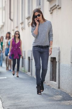 Capucine Safyurtlu in a grey sweater + black skinny jeans + lace-up heels