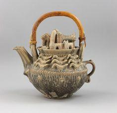 Ian Godfrey (British, 1942-1992) A large Teapot with Village Scene, circa 1970