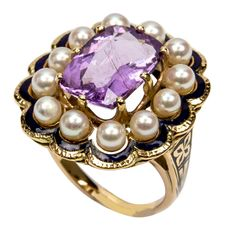 Edwardian Cushion-Cut Tourmaline Pearl Enamel Gold Ring. An Outstanding Early 1900s Edwardian Ring, center set with a faceted cushion-cut purplish blue Indicolite Tourmaline surrounded by twelve Pearls Gold enhanced with blue enamel accents; in 14k yellow gold