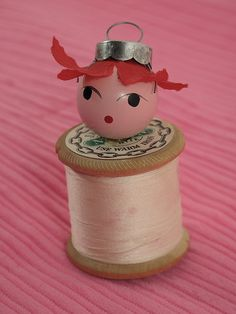 just playing with spools of thread, doll heads and ornament hooks--all vintage. I really like her despite the fact that my 6 year old stained her with rasberry hands! Custom imprinted ornaments are great fundraisers! Handmade Ornaments, Diy Christmas Ornaments, Christmas Projects, Christmas Art, Holiday Crafts, Vintage Christmas, White Christmas, Christmas Ideas, Wooden Spool Crafts