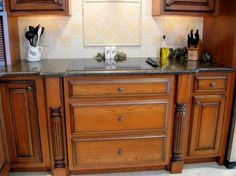 This rich cherry kitchen featured a glazed finish, rope molding, raised panels, turnings, and stone countertops. Cherry Kitchen, Secret Compartment, Stone Countertops, Raised Panel, Kitchen Cabinets, Storage, Kitchens, Home Decor, Secret Compartment Furniture