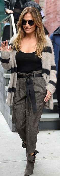Who made  Jennifer Lopez's tan and black stripe cardigan sweater and brown suede boots?