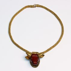 Bid 6/30 for this unique and rare #Etruscan #gold and red jasper necklace 7th century #BC 32 cm (12,59 in) long; 49,7 (1,600 oz) grams; loop-in-loop chain, terminating in tubular collars and joined to a ring-shaped hook-and-loop closures, the chain supporting an extremely precious #red jasper #pendant in the form of a #bull protome, tubular suspension loop, horns, ears and base of the pendant finely decorated with rows of granulation…