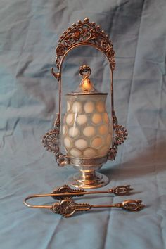 "Antique Figural ""Love Birds"" Opalescent Coin Dot Pickle Castor. These castors were popular in the 19th century. The Barbour Silver Co. began in Hartford CT, but was closed in 1894. The bottom reads, ""Barbour Bros Conn Quadruple"". The castor is a rare example of early coin dot opalescent glass (smooth on the outside and the coin dots are bubbles on the inside). The frame has 2 love birds in the top section of the frame. The fram also features flowers and other fancy detail. The glass castor is..."