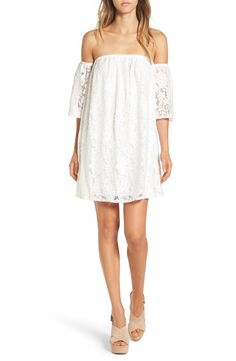 Tap into the off-the-shoulder trend with this gorgeous shift dress layered with beautiful white lace.