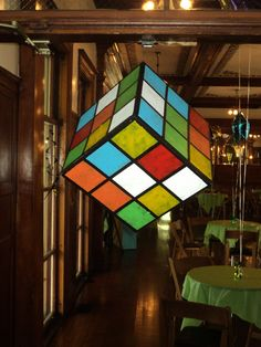 Giant cardboard rubik's cube. Perfectly affordable and easy to create 80's & 90's party decoration.  https://www.facebook.com/ThriftyCraftEvents