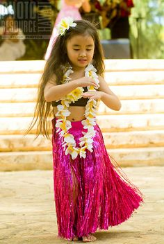 Hula dancer performs at Kapiolani Park Bandstand on May Day, also known in Hawaii as Lei Day