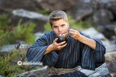 Post Falls High School Senior Portrait, river front Japanese themed senior photo, fun photo of male senior eating rice by water, playful Post Falls senior photographer, http://www.jeremiahandrews.com/image-galleries/high-school-seniors
