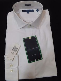 The polished look of this solid white dress shirt from Tommy Hilfiger. A slim fit is cut closer through the chest, sleeves and waist. Slim fit. Features slim armholes and sleeves. Spread collar. | eBay!