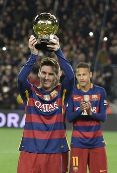 Barcelona's Argentinian forward Lionel Messi poses with his fifth Ballon d'Or trophy before the Spanish league football match FC Barcelona vs Athletic Club Bilbao at the Camp Nou stadium in Barcelona on January 17, 2016.