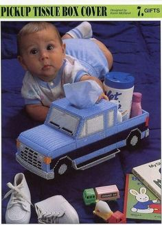 Nursery tissue box cover shaped like a truck, could be done with cardboard and paint I'm sure!