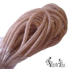 Jute Flex Tubing Size: 8 mm x 30 yards Color: Natural Burlap Material: Jute, synthetic poly Jute Flex Tubing with the water resistant and lightweight properties of poly with natural