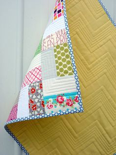 Simple baby quilt with straight line quilting.