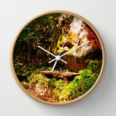 A rock, a bench and some forest Wall Clock