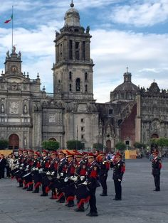 we love mexico city.  pictured here the changing of the guard.  while not quite as elaborate as a buckingham palace - it's stately and appropriate in front of the beautiful palace in mexico city