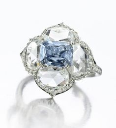 A Fancy Intense, Blue Diamond 'Lotus' Ring, of 1.15 carats, by Bhagat. ~ 35 Gorgeous Diamonds - Style Estate -