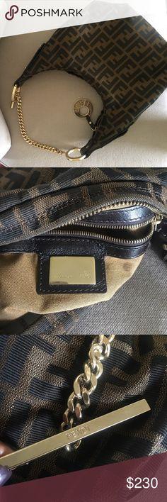Shop Women s Fendi Brown Tan size OS Hobos at a discounted price at  Poshmark. Description  Pre-Loved Authentic Fendi Hobo Monogram Chain  Handbag that never ... 8f31b7eace805