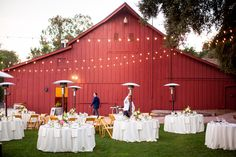 The big red barn, string lights, and beautiful tables a perfect reception! #santabarbaraevents #wineryweddings #perfectday Amazing photos taken by http://wordenphotography.pass.us/ www.cateringconnection.com
