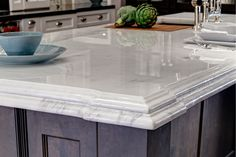 Marble details in stunning and glamorous kitchen.