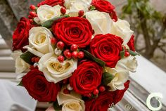 Bride's bouquet of red and ivory roses with berries