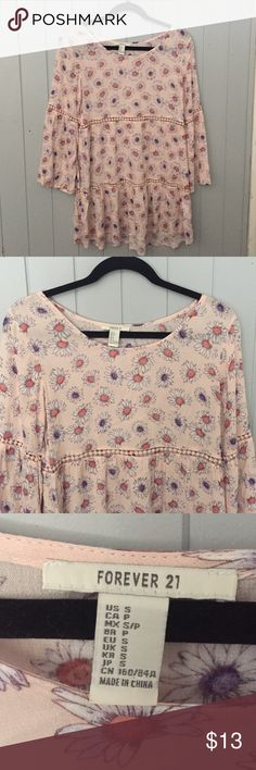 Pink floral dress Bought this impulsively and never wear it. Only worn once for a few hours. Pink dress with daisies on it! Bell sleeves. Feel free to make an offer. ***i do live with cats so if you need me to wash it prior to shipping I can do that*** Forever 21 Dresses Mini