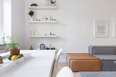 leather and grey, what to put on a floating white shelf