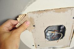 How to patch drywall around a ceiling hole that's too big for your new light fixture