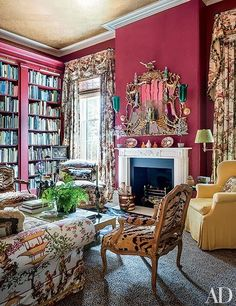 cherry-red library, a Chinoiserie fabric was used for the curtains and upholstery; the gilded 18th-century mirror Mario Buatta and Patricia Altschul Exude Southern Charm in Charleston- The Glam Pad
