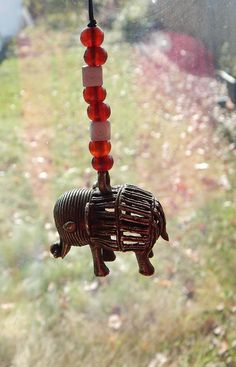 Wooden africa necklace wood africa jewelry beaded africa shape african elephant car charm brass rear mirror accessories africa bronze beaded carved ethnic afrocentric beaded red mozeypictures Choice Image