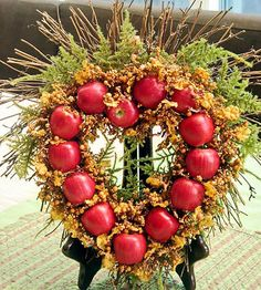 Apple Wreath     Greet the harvest season with a wreath of apples. Hot-glue mini or full-size apple replicas to the wreath of your choice