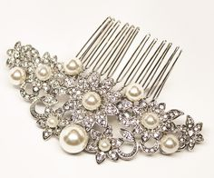 Rhinestone & pearl floral bridal hair comb featuring high quality rhinestones and glass pearls set in a soft silver setting in a gorgeous flower design.  This vintage inspired rhinestone and pearl flower bridal hair comb is great for your elegant or romantic wedding day look.