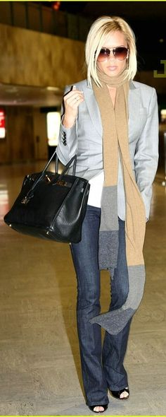 Victoria Beckham in a grey blazer with long scarf. Boot cut jeans and peep toe patten leather pumps. Black purse. Love this whole outfit! Love her hair!