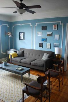 I love the wall colour (Benjamin Moore's Jamestown Blue) and the white border.  It looks a bit like the showroom of Dedar on Rue Bonaparte in Paris.