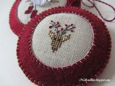 cross stitch and wool ormaments. Lovely finish!