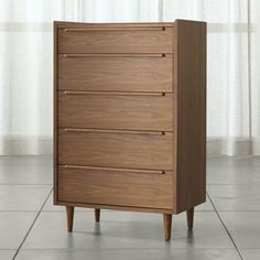 From a tall chest of drawers to a low-profile dresser, Crate and Barrel offers storage solutions designed to fit your space. Order dressers online.