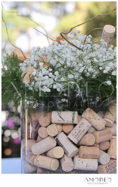Wine Cork Wedding Decorations, Wine themed weddings, Wine Corks in Flower Vases, Winery-themed Wedding, Winery Inspired Wedding, Wedding Cork Centerpiece, Wedding Cork and Wildflowers, Shabby Chic Wedding, DYI wedding centerpiece, do-it-yourself wine cork reception centerpiece, babys breath flower arrangements, Fall Wedding Flowers, Spring Wedding Flowers, Summer Wedding Flowers, www.AmodeoPhotogr... 2013 AmodeoPhotography... All Rights Reserved.