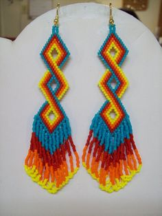 Native American Style Beaded Twisted Earrings in Turquoise, Red, Orange and Yellow Delcia Beads Sout Seed Bead Jewelry, Seed Bead Earrings, Beaded Earrings, Beaded Jewelry, Yellow Earrings, Beaded Bracelets, Angel Earrings, Seed Beads, Bead Earrings