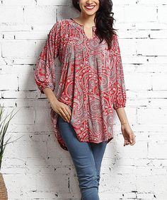 Add a simply elegant accent to your ensemble with this flowing tunic that boasts a timeless paisley pattern and is crowned with a sophisticated notched neckline. Shipping note: This item is made for zulily. Allow extra time for your special find to ship.