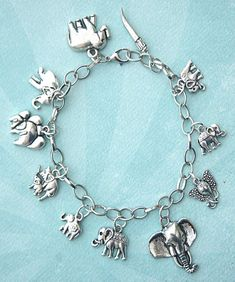 This charm bracelet features elephant tibetan silver charms. The charms are attached to a silver tone chain bracelet that measures 7.5 inches in length. Elephant Theme, Silver Charms, Boho Jewelry, Jewelry Box, Charm Bracelets, Elephants, Dog Lovers, Beautiful Dresses, 3