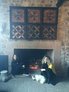 Fireplace, sisters and Polly at la casella