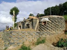 Paxan School Building - With Tire Retaining Wall in Foreground Natural Building, Green Building, Paintball, Recycled House, Recycled Tires, Earthship Home, Tyres Recycle, Upcycle, Used Tires