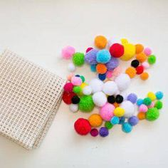 If you like those colorful felt ball rugs but they can be pricey, you can make one yourself! Here's an inexpensive and cute little version using pompoms Diy Pom Pom Rug, Pom Pom Crafts, Diy Carpet, Rugs On Carpet, Felt Ball Rug, Ikea Rug, Faux Fur Rug, Farmhouse Rugs, Orange Area Rug