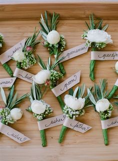 fashion for the groom - green boutonnieres with white flowers | JenFariello